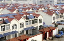 Solar panels are seen on the roofs of residential houses in Qingnan village of Lianyungang