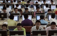 Customers use computers at an internet cafe in Taiyuan, Shanxi province