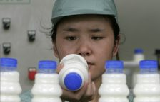 An employee works at a production line inside the factory of Wahaha Group in Hangzhou