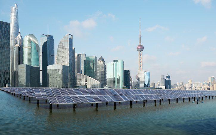 Eco-environmentally friendly green energy of sustainable development of solar power plant with Shanghai skyline